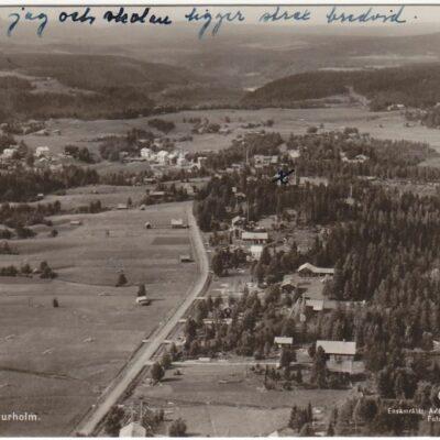 Flygfoto över Bjurholm Förl: Anderssons Pappershandel, Bjurholm, Tel. 9 Poststämplat 3/9 1942 Ägare: Åke Runnman 9x14