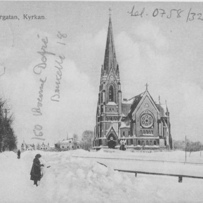 Umeå, Storgatan, Kyrkan Reinhold Hjortsbergs Pappershandel Poststämplat 7/1 1965 Ägare: Åke Runnman 9x14