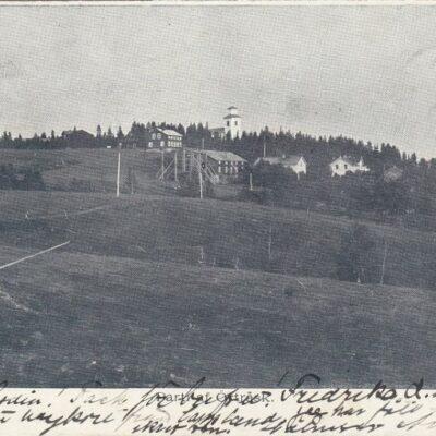 Parti af Örträsk. A.E. Fotot är taget av Emma Königsson Postat 16/2 1902 i Fredrika Ägare: Åke Runnman 9x14