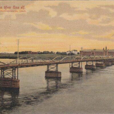 Umeå. Bron öfver Ume elf Maria Edgrens Hvitvaruaffär, Umeå Poststämplat 23/1 1907 Ägare: Ivar Söderlind