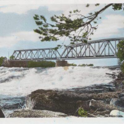 Järnvägsbron. Lycksele Förlag: Bodéns Bokhandel. Lycksele Handkolorerat Foto: 28/4 1952 Ägare: Åke Runnman 9x14